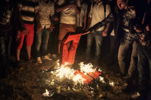 2015. Greece. Kos. Syrians who have arrived on the Greek island of Kos burn their life jackets for warmth and to attract the attention of the police. This group of Syrians arrived on a corner of the island which is not very accessible and, not knowing what to do, try to use the fire to attract the attention of the coast guard.