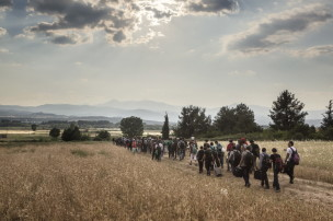 2015. Idomeni. Greece. A group of around 150 Syrians sets off to cross the Greek border with the Former Yugoslav Republic of Macedonia (FYROM), with the hope of being able to apply for refugee status in countries such as Germany or Sweden. The Greek border with the FYROM is increasingly under the control of people-traffickers, and is becoming less safe each day, so migrants try to cross the border in large groups so they can defend themselves from any extortion. 6 June 2015.